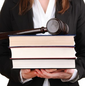 Lawyer Holding a Gavel and Some Books