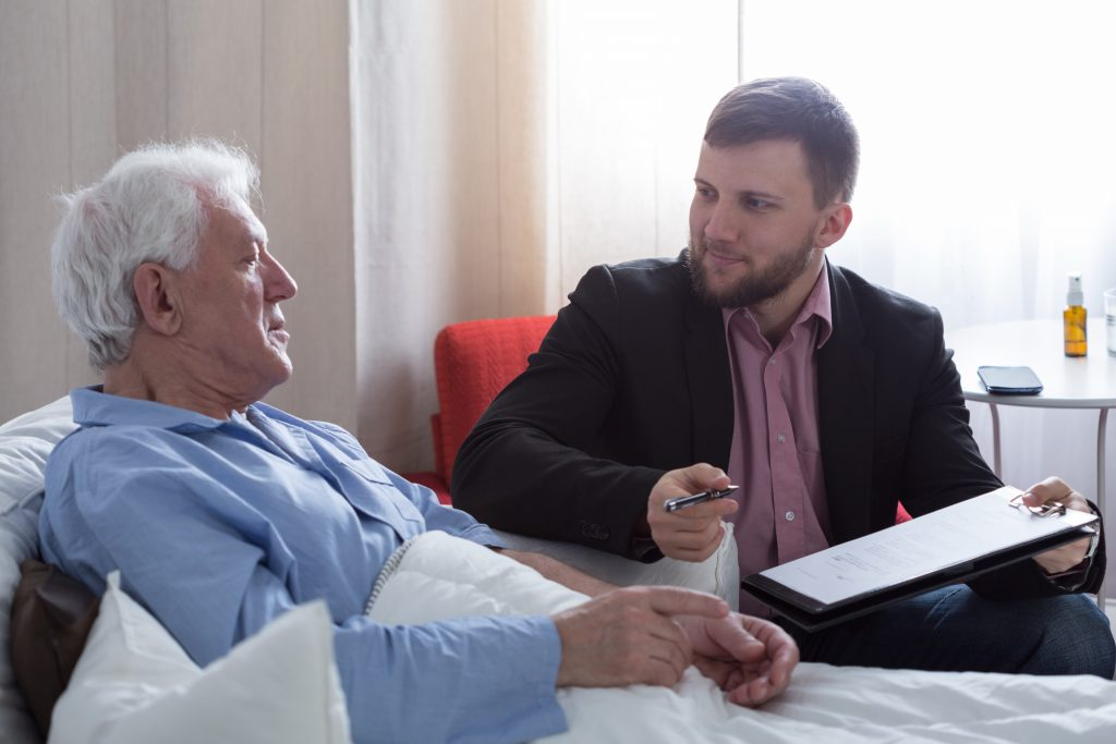 Senior talking to lawyer about his will