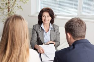 Lawyer discussing marital agreement to her clients