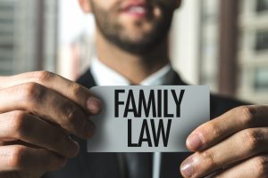 Lawyer holding a note with written text as family law