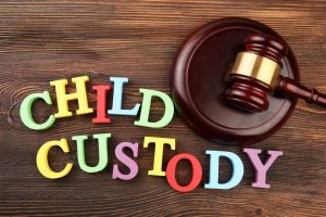 Colorful child custody letters and a gavel
