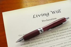 Living will paperwork and a pen