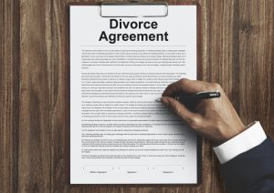 Divorce agreement paperwork being signed