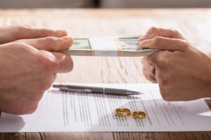 Divorce agreement contract with couple fighting over money
