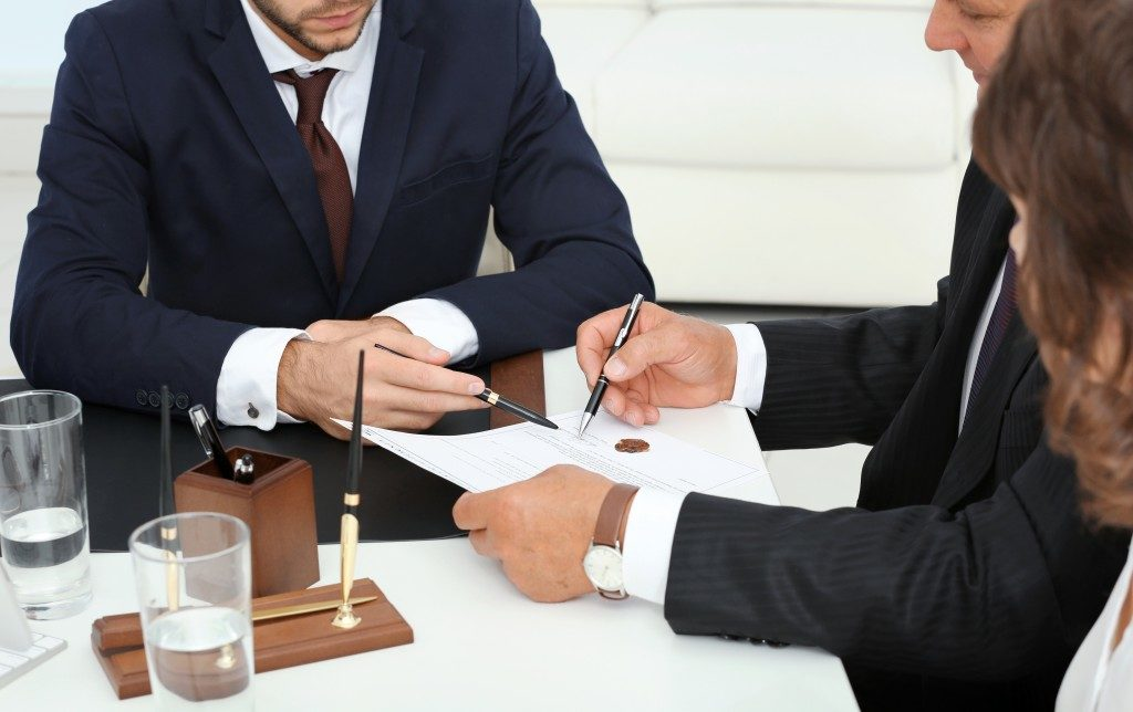 Couple consulting a lawyer