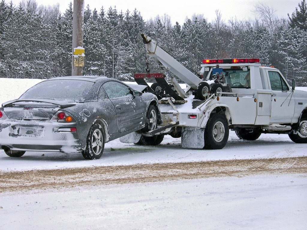 car being towed in snowy weather