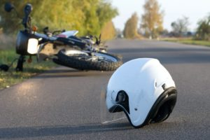 Motorcylce and helmet on the road