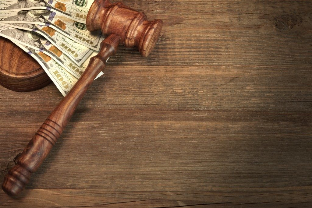 Money near a wooden gavel
