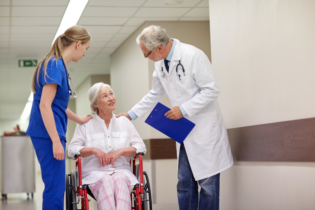 doctor and nurse with senior patient